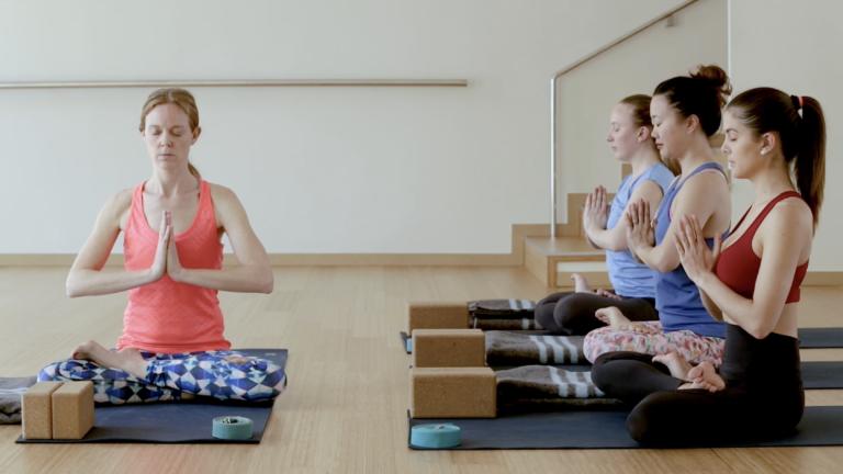 Photo of people doing yoga
