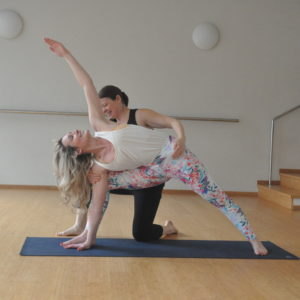 Image of Two girls doing Yoga