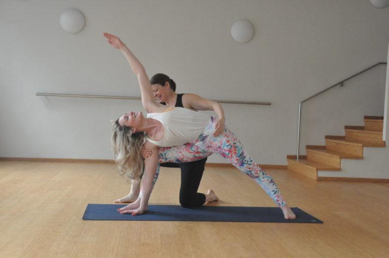 Image of Two girls doing Yoga